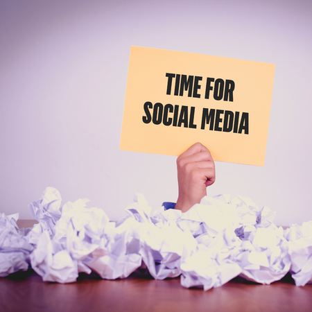 textcloud: HAND HOLDING YELLOW PAPER WITH TIME FOR SOCIAL MEDIACONCEPT Stock Photo