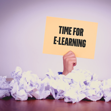 instances: HAND HOLDING YELLOW PAPER WITH TIME FOR E-LEARNINGCONCEPT
