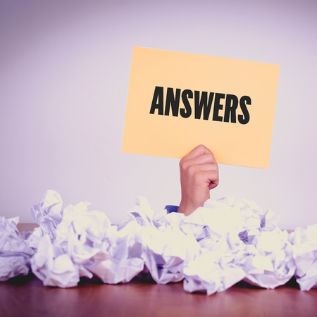 warranty questions: HAND HOLDING YELLOW PAPER WITH ANSWERSCONCEPT Stock Photo