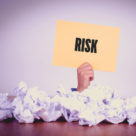 avoidance: HAND HOLDING YELLOW PAPER WITH RISKCONCEPT Stock Photo