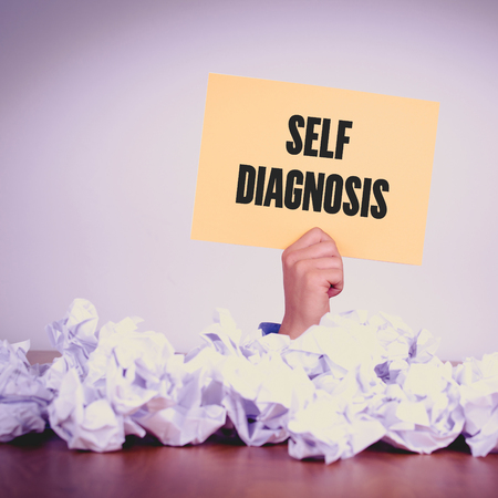 selfcontrol: HAND HOLDING YELLOW PAPER WITH SELF DIAGNOSISCONCEPT
