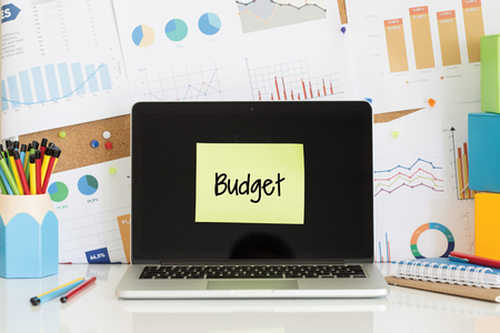 deficit target: BUDGET sticky note pasted on the laptop screen