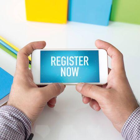 Man holding smartphone which displaying Register Now
