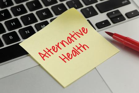 alternative health: Alternative Health sticky note pasted on the keyboard