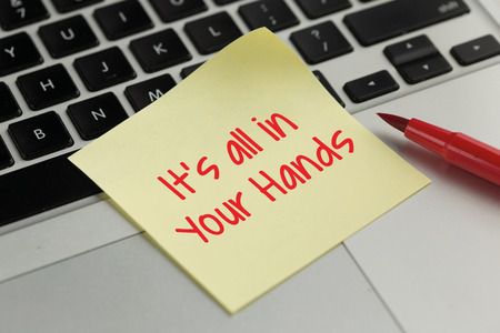 sticky hands: Its All In Your Hands sticky note pasted on the keyboard