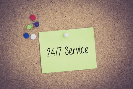 24x7: 247 Service written on sticky note pinned on pinboard Stock Photo