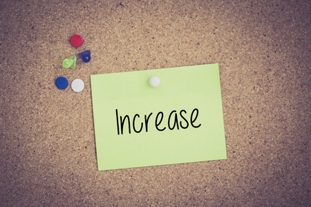 stock predictions: Increase written on sticky note pinned on pinboard