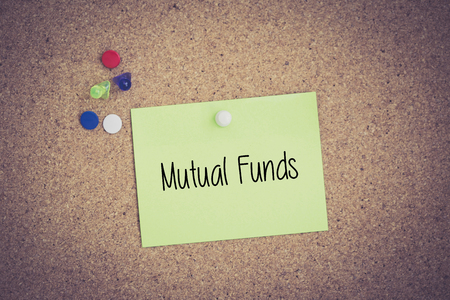 financial diversification: Mutual Funds written on sticky note pinned on pinboard Stock Photo