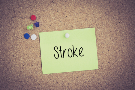 medicaid: Stroke written on sticky note pinned on pinboard Stock Photo
