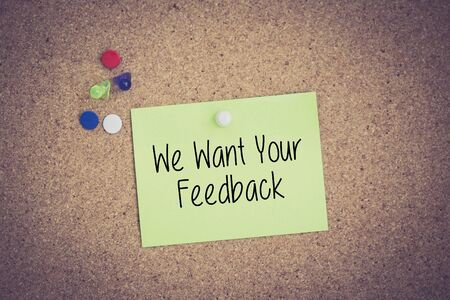 We Want Your Feedback written on sticky note pinned on pinboard