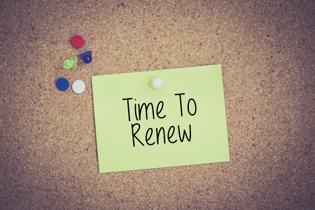 Time To Renew written on sticky note pinned on pinboard