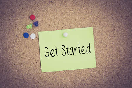 commence: Get Started written on sticky note pinned on pinboard