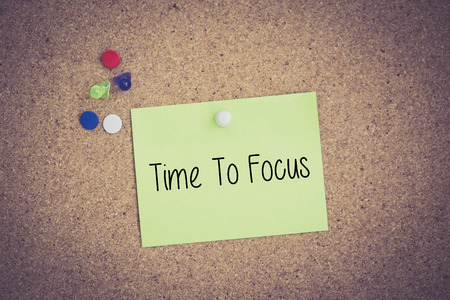 distinctness: Time To Focus written on sticky note pinned on pinboard Stock Photo