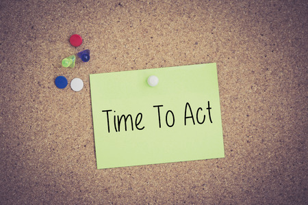 expiring: Time To Act written on sticky note pinned on pinboard