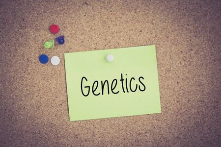 genomes: Genetics written on sticky note pinned on pinboard