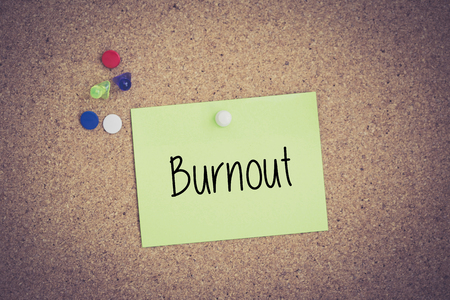unmotivated: Burnout written on sticky note pinned on pinboard
