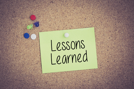 summarize: Lessons Learned written on sticky note pinned on pinboard