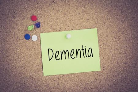 losing knowledge: Dementia written on sticky note pinned on pinboard