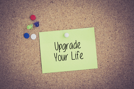 life extension: Upgrade Your Life written on sticky note pinned on pinboard