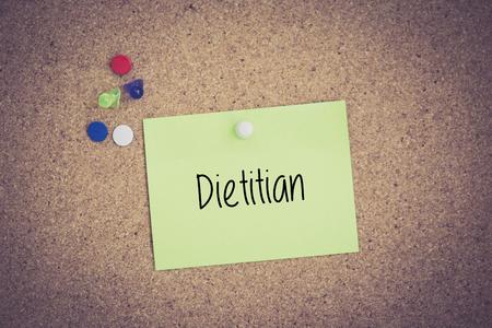 dietitian: Dietitian written on sticky note pinned on pinboard