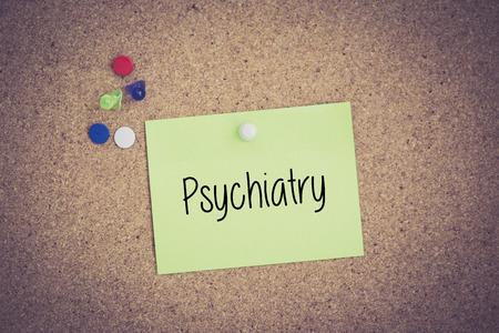 psychiatry: Psychiatry written on sticky note pinned on pinboard