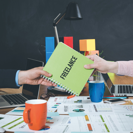 freelance: Man giving book which written Freelance