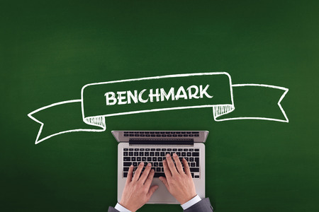 benchmark: PEOPLE WORKING OFFICE COMMUNICATION  BENCHMARK TECHNOLOGY CONCEPT Stock Photo