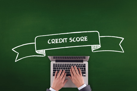 repay: PEOPLE WORKING OFFICE COMMUNICATION  CREDIT SCORE TECHNOLOGY CONCEPT Stock Photo