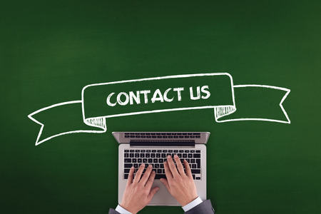 contactus: PEOPLE WORKING OFFICE COMMUNICATION  CONTACT US TECHNOLOGY CONCEPT Stock Photo
