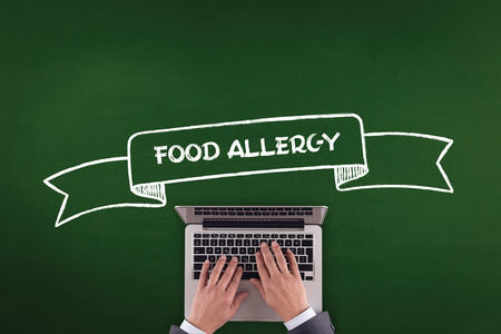 food allergy: PEOPLE WORKING OFFICE COMMUNICATION  FOOD ALLERGY TECHNOLOGY CONCEPT Stock Photo