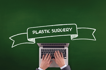 adult  body writing: PEOPLE WORKING OFFICE COMMUNICATION  PLASTIC SURGERY TECHNOLOGY CONCEPT Stock Photo