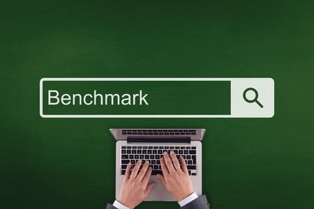 benchmark: PEOPLE WORKING OFFICE COMMUNICATION  BENCHMARK TECHNOLOGY SEARCHING CONCEPT Stock Photo