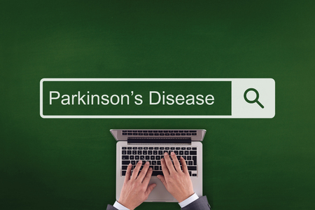 PEOPLE COMMUNICATION HEALTHCARE  PARKINSONS DISEASE TECHNOLOGY SEARCHING CONCEPT Stock Photo