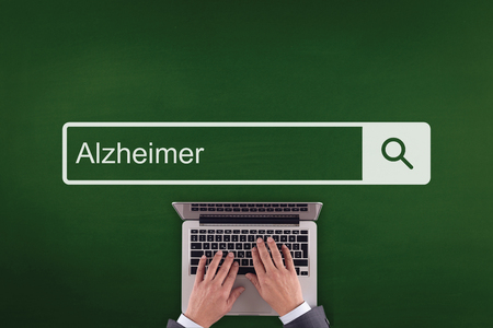 finding a cure: PEOPLE COMMUNICATION HEALTHCARE  ALZHEIMER TECHNOLOGY SEARCHING CONCEPT Stock Photo