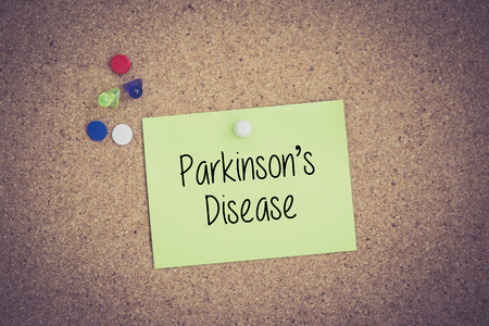 midbrain: Parkinsons Disease written on sticky note pinned on pinboard
