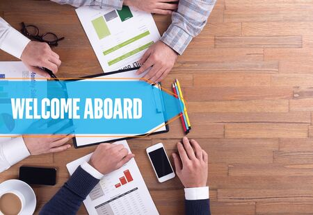 welcome desk: BUSINESS TEAM WORKING OFFICE WELCOME ABOARD DESK CONCEPT Stock Photo