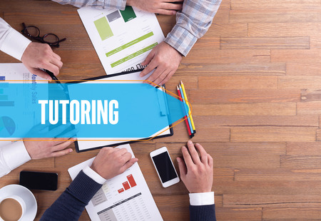 indoctrination: BUSINESS TEAM WORKING OFFICE TUTORING DESK CONCEPT Stock Photo