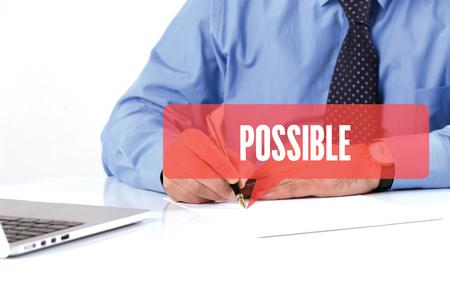 unachievable: BUSINESSMAN WORKING OFFICE  POSSIBLE COMMUNICATION SPEECH BUBBLE CONCEPT Stock Photo