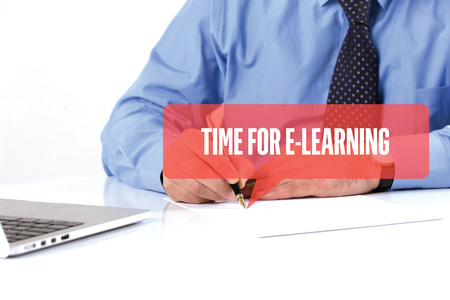BUSINESSMAN WORKING OFFICE  TIME FOR E-LEARNING COMMUNICATION SPEECH BUBBLE CONCEPT Stock Photo