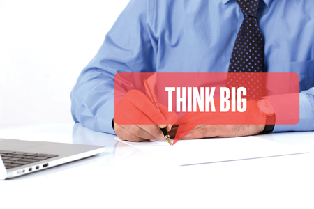 overachieving: BUSINESSMAN WORKING OFFICE  THINK BIG COMMUNICATION SPEECH BUBBLE CONCEPT