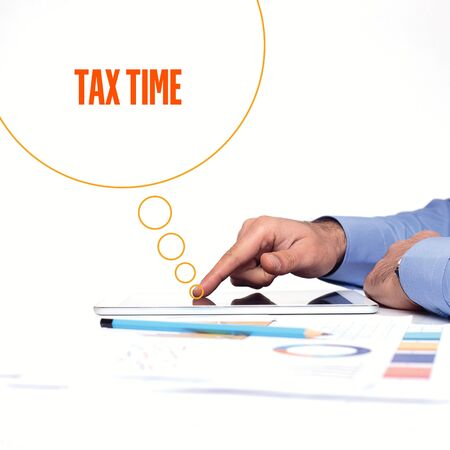 rate of return: BUSINESSMAN WORKING OFFICE  TAX TIME COMMUNICATION TECHNOLOGY CONCEPT