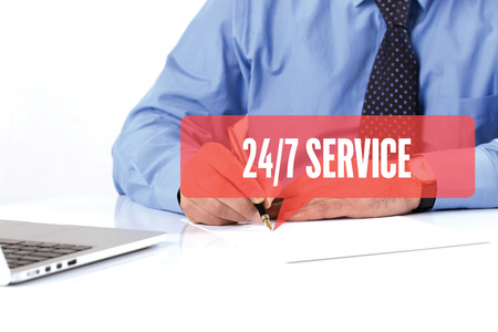 24x7: BUSINESSMAN WORKING OFFICE  247 SERVICE COMMUNICATION SPEECH BUBBLE CONCEPT Stock Photo