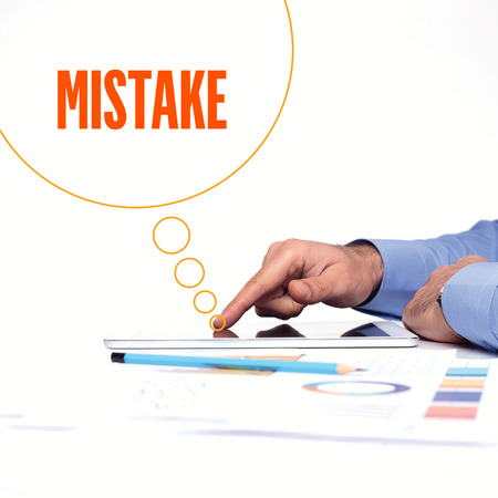 mistake: BUSINESSMAN WORKING OFFICE  MISTAKE COMMUNICATION TECHNOLOGY CONCEPT Stock Photo
