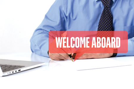 aboard: BUSINESSMAN WORKING OFFICE  WELCOME ABOARD COMMUNICATION SPEECH BUBBLE CONCEPT Stock Photo