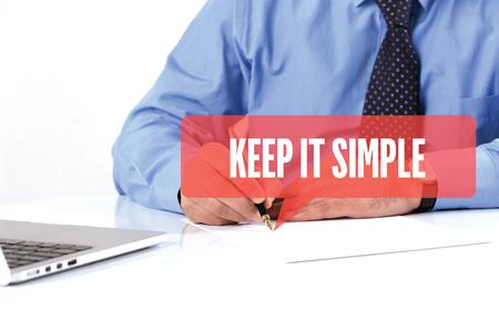 cogent: BUSINESSMAN WORKING OFFICE  KEEP IT SIMPLE COMMUNICATION SPEECH BUBBLE CONCEPT