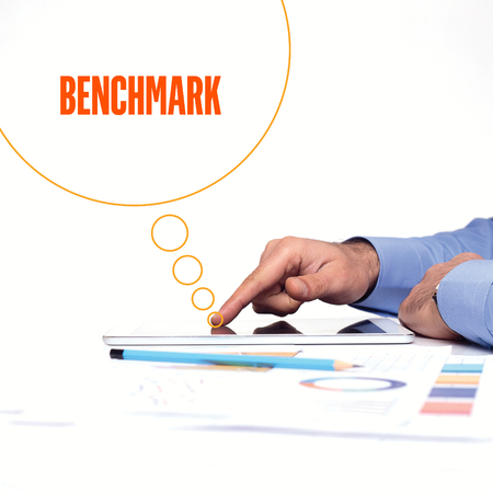 benchmark: BUSINESSMAN WORKING OFFICE  BENCHMARK COMMUNICATION TECHNOLOGY CONCEPT