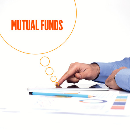 mutual: BUSINESSMAN WORKING OFFICE  MUTUAL FUNDS COMMUNICATION TECHNOLOGY CONCEPT