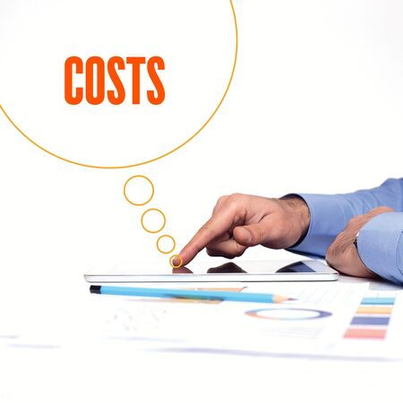 reorganization: BUSINESSMAN WORKING OFFICE  COSTS COMMUNICATION TECHNOLOGY CONCEPT Stock Photo