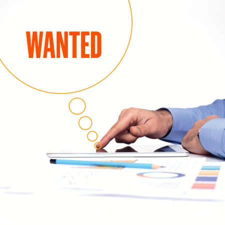 recruit help: BUSINESSMAN WORKING OFFICE  WANTED COMMUNICATION TECHNOLOGY CONCEPT Stock Photo