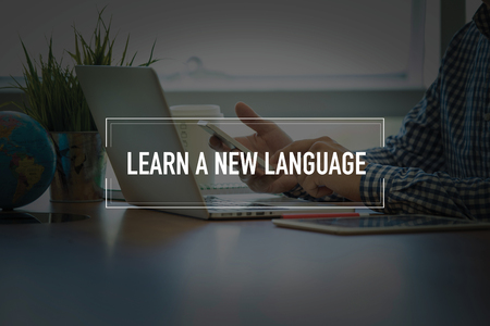 fluency: PEOPLE USING SMARTPHONE COMMUNICATION TECHNOLOGY  LEARN A NEW LANGUAGE OFFICE CONCEPT Stock Photo